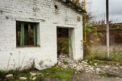 Abandoned warehouse and industrial buildings and buildings. Are covered with garbage and overgrown with bushes and grass Royalty Free Stock Photography