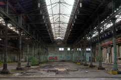 Abandoned Warehouse. Large abandoned warehouse with a large steel beam royalty free stock photography