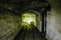 An abandoned warship ammunition transport tunnel with the remains of a narrow gauge railway. Under Sevastopol Royalty Free Stock Photos