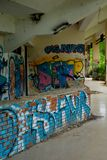 Abandoned water park, Hue. Old devastated building in old water park complex near to Vietnam town Hue. On the wall are color graffiti royalty free stock photography