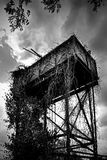 Abandoned Water Tower - Essex UK. An abandoned water-tower engulfed by ivy vines - Essex UK Royalty Free Stock Photo