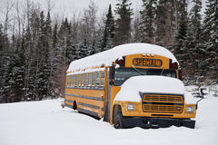 Abandoned weird school bus. In the snow Royalty Free Stock Photo