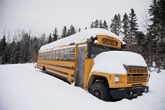 Abandoned weird school bus. In the snow Stock Photography