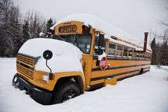 Abandoned weird school bus. In the snow Royalty Free Stock Photos