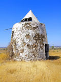Abandoned Windmill. Closeup on the ruins of an abandoned windmill on the countryside Stock Image