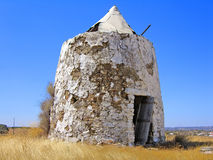 Abandoned Windmill. Closeup on the ruins of an abandoned windmill on the countryside Stock Photography