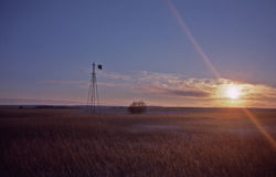 Abandoned windmill. At sunrise in the Western Prairie of the USA Royalty Free Stock Photos