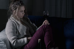 Abandoned woman drinking wine alone Royalty Free Stock Image