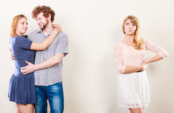 Abandoned woman with enamored couple Royalty Free Stock Photos