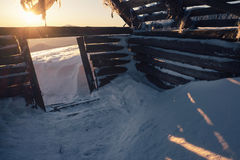 Abandoned wood house in the winter mountains at sunrise Royalty Free Stock Photo