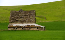 Abandoned wooden barn. Old abandoned barn in advanced stage of decay in the Palouse region of Washington state in the US stock photo