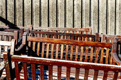 Abandoned Wooden Benches. Engraved with CITY OF LONDON piled against a concrete wall royalty free stock image