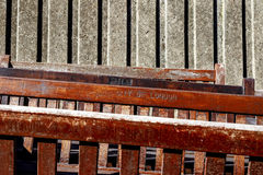 Abandoned Wooden Benches. Engraved with CITY OF LONDON piled against a concrete wall stock photos