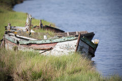 Abandoned wooden boat. Old abandoned and damaged, wooden boat royalty free stock image