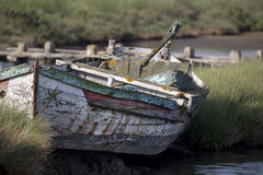 Abandoned wooden boat. Old abandoned and damaged, wooden boat stock image