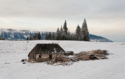Abandoned wooden cottage in the mountain Stock Photos