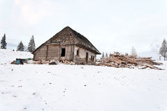 Abandoned wooden cottage in the mountain Stock Images