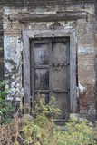 Abandoned wooden door in brick stone wall Stock Photos