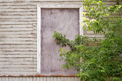 Abandoned wooden house with boarded up windows Stock Images