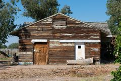 Abandoned wooden house that is deteriorating royalty free stock photo