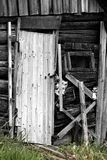 Abandoned wooden house, door to barn. The dying Russian village Royalty Free Stock Photos