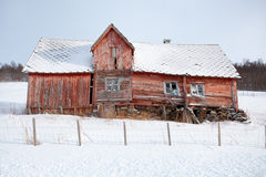Abandoned wooden house in the snow Royalty Free Stock Images