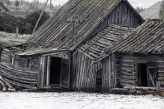 Very original houseboat village on lake. Abandoned wooden house. Very original houseboat village on lake, lake-habitation. Dying Russian village Stock Images