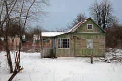 Abandoned wooden house in the winter Stock Photography