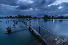 Abandoned wooden jetty at dusk Royalty Free Stock Photography