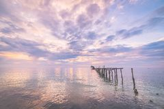 Abandoned wooden jetty at dusk, toned image Royalty Free Stock Photos