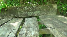 Abandoned wooden table with bench in mountain. This is a footage of Abandoned wooden table with bench in mountain stock footage