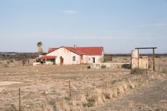 Abandoned farm house on a dry farm. Abandoned and worn down farm house on a dry farm Stock Photo