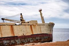 Abandoned wreck old ship near shore Stock Photo