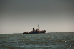 Abandoned wrecked ship in seaside landscape royalty free stock photos