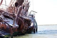 Abandoned wrecked ship, seaside landscape stock image