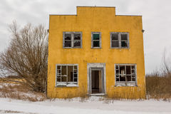 Abandoned yellow building. Abandoned yellow stucco building in the winter Royalty Free Stock Photos