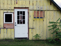 Abandoned Yellow House with Christmas Stocking Stock Images