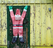 Abandoned Yellow House with Strange Santa Claus Stock Photography