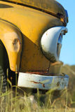 Abandoned yellow truck. An abandoned yellow truck rusting in a field Stock Photo