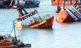 Abandoneold rusty ships in the Port of Montevideo, Uruguay. Old ship grave yard. Stock Images