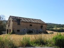 Casa Abbandonata. The abandonment of a country house surrounded by the nature that surrounds it has now become a ruin Royalty Free Stock Photo