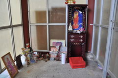 Abandonment of figure of Buddha. Buddha abandoned, lonely lying in the corner, they also enjoyed before Stock Photos