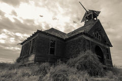 Abandonment. A spooky abandoned old schoolhouse building Royalty Free Stock Photography