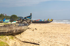 Abandonned artistic wooden canoe on a lonely beach. In India, Kerala royalty free stock photography