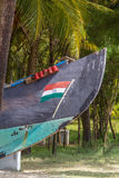 Abandonned artistic wooden canoe on a lonely beach. In India, Kerala royalty free stock images