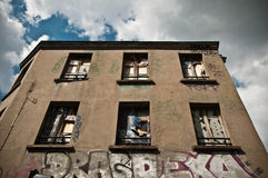 Abandonned building. Abandoned building facade with graffiti stock images