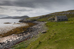 Abandonned cottage on the Isle of Barra. Abandonned crofters cottage next to the sea on the Isle of Barra in The Outer Hebrides Stock Photography