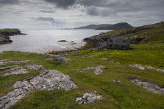 Abandonned cottage on the Isle of Barra. Abandonned crofters cottage next to the sea on the Isle of Barra in The Outer Hebrides Royalty Free Stock Images