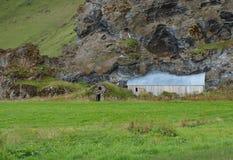 Abandonned farm, Iceland. Abandonned farm under a lava rock face Stock Photography
