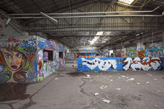 Abandonned industrial place with graffitis Stock Photography